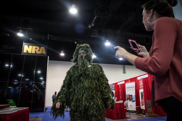 "Geoff Krumwiede of Regnery Publishing dressed as a ""swamp monster"" as he wandered the conference."