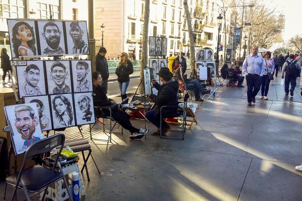 Caricaturists line Barcelona's busy tourist thoroughfare, La Rambla.