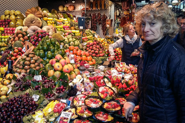 "Rocí Gayo, who has sold fruit in Barcelona's La Boquería market for 20 years, says she's fed up with tourists who crowd the market passageways to take photos but don't buy anything. ""Out of 20 tourists, if I'm lucky, maybe one will buy one piece of fruit — but no more,"" she says."
