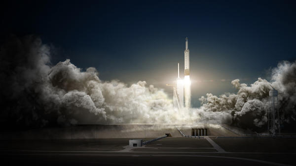 SpaceX says its Falcon Heavy rocket, shown here in an artist's rendering, will be used in the mission to the moon.