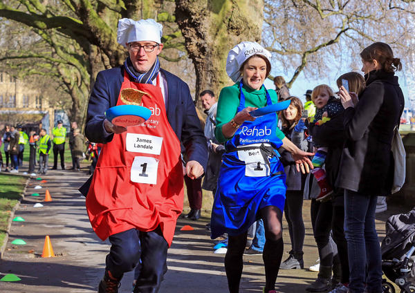 James Landale of BBC News and Baroness Bertin of the House of Lords pictured at the Rehab Parliamentary Pancake Race 2017, in which the members of Parliament's team secured victory for the second year in a row.