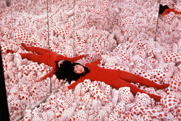 "Yayoi Kusama in her <em>Phalli's Field</em> infinity room in 1965. Art dealer Richard Castellane says Kusama ""shocked the living daylights out of people"" with her art."