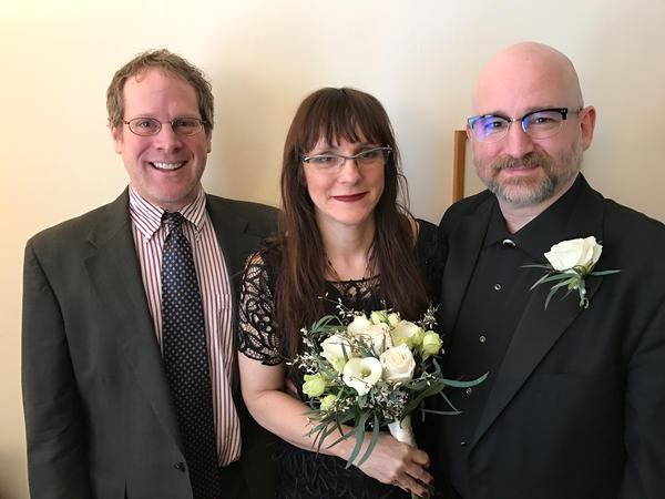 Donald Boyer (right) and Ann Justi celebrate their wedding with Rabbi Andy Dubin at their home in Yonkers, N.Y.
