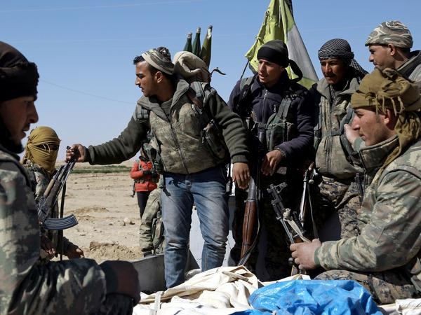 U.S.-backed Syrian Democratic Forces, made up of an alliance of Arab and Kurdish fighters, regroup on the northern outskirts of Deir Ezzor as they advance to encircle the ISIS bastion of Raqqa on Feb. 21.
