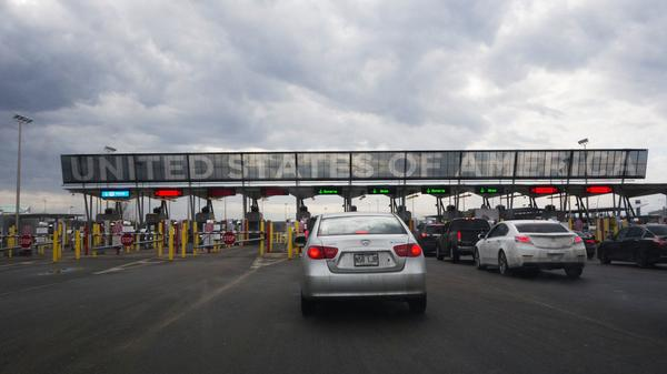 Cars line up to cross into the U.S. at the Canadian border on Feb. 25, in Saint-Bernard-de-Lacolle, Quebec.