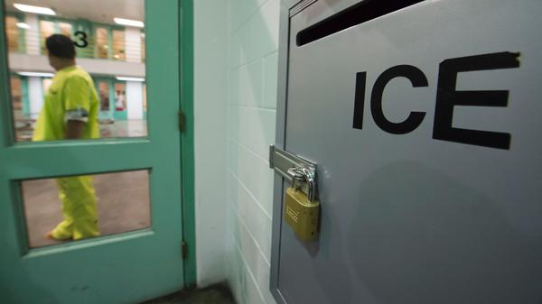 An immigration detainee stands near a U.S. Immigration and Customs Enforcement (ICE) grievance box last month in the high security unit at the Theo Lacy Facility, a county jail in Orange, Calif., that also houses immigration detainees arrested by ICE.