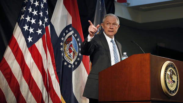 Attorney General Jeff Sessions has ordered a review of all Justice Department agreements with cities about police conduct. He is pictured speaking about crime to local, state and federal law enforcement officials last week in St. Louis.
