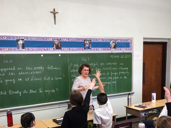 Amy Clayton teaches a fifth-grade history class at St. Jerome Academy in Hyattsville, Md. The school, which almost closed eight years ago, has experienced growth over the past few years, largely due to an influx of Catholic families who were drawn to Hyattsville by a desire to live among others who share their values.