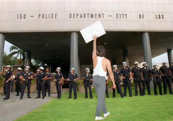 A demonstrator protests the verdict in the trial of four Los Angeles police officers accused of beating motorist Rodney King outside the Los Angeles Police Department headquarters on April 29, 1992. Riots broke out in Los Angeles after a jury acquitted the four police officers accused of beating King.