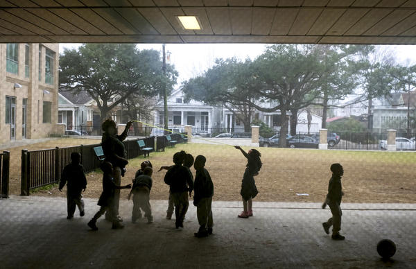 Young children play outside in the fog at Crocker College Prep, an elementary school in New Orleans.