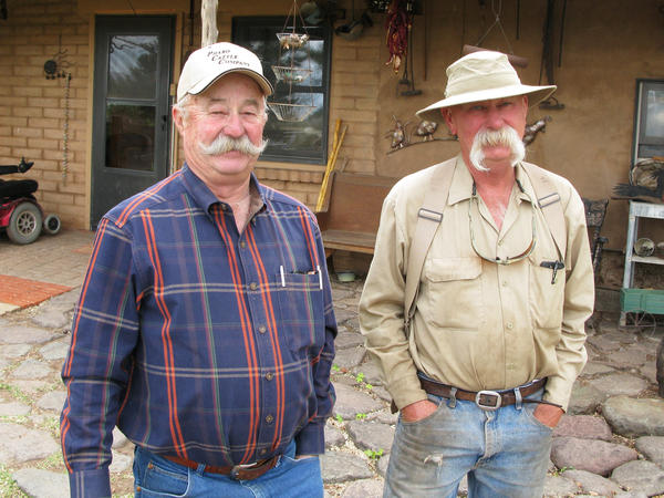 Albert Miller (left) and his brother Bill run cattle on their ranches 10 miles from the Rio Grande and they think the harsh terrain acts as a better deterrent than a manmade barrier ever would.