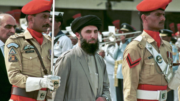 Warlord Gulbuddin Hekmatyar is shown in Kabul with an honor guard in 1996. The Taliban captured the capital later that year.