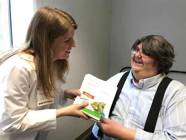 Registered dietitian Anna Ziegler counsels Tom Shicowich, who has Type 2 diabetes. Since enrolling in the Fresh Food Pharmacy program, Shicowich has lost about 45 pounds. His hemoglobin A1C level has dropped significantly.