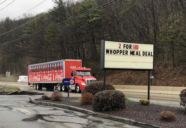 A Coca-Cola truck drives past a Burger King in Northumberland County, Pa. More than 40 percent of county residents have conditions that put them at risk of diabetes, and 14.2 percent of households are food-insecure.