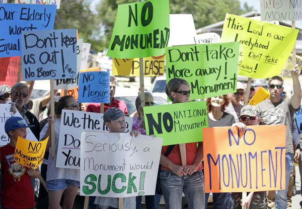 Opponents of designating Bears Ears a national monument protest after then-U.S. Interior Secretary Sally Jewell arrived for a meeting with San Juan County commissioners in Monticello, Utah, on July 14, 2016.