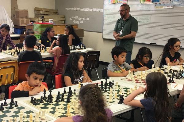 Coach Ted Komada motivates his chess team in preparation for the SuperNationals of chess, this week in Nashville, Tenn.