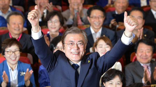 South Korean presidential candidate Moon Jae-in of the Democratic Party of Korea reacts to exit polls suggesting his victory, in the National Assembly in Seoul, South Korea, on Tuesday.