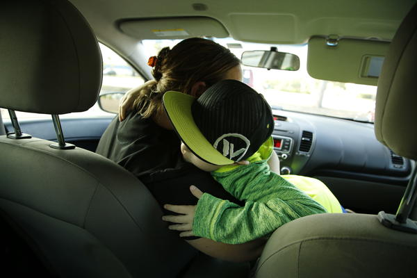 Ayden and his mom, Lynn, hug after visiting the McDonald's drive-through in Port St. Lucie, Fla.