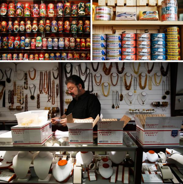Top: Gifts for sale in the many tourists shops that line downtown Ketchikan. Bottom: Roman Schwartz sets up his shop — Czar's Treasures.