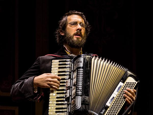 Groban's Pierre plays piano and accordion on stage, in addition to singing.