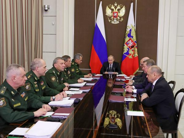 Russian President Vladimir Putin chairs a meeting of top executives of the Defense Ministry and military-industrial complex in the Black Sea resort of Sochi, Russia, Friday, May 19, 2017.
