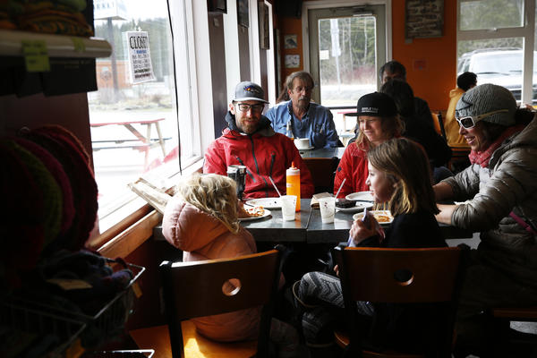 Life goes on in Haines: Friends at lunch inside Mountain Market, a cafe and grocery store.