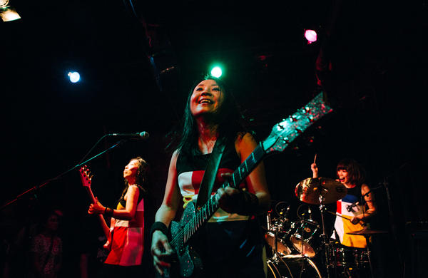 Shonen Knife performs at the Black Cat in Washington, D.C., on April 30. For over 35 years, the all-female trio has been serving up catchy punk songs with a delicious twist: Many are about a love of food.