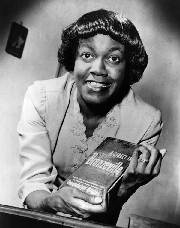 Gwendolyn Brooks poses with her first book of poems, <em>A Street in Bronzeville.</em>