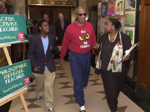 Bill Cosby, wearing a Temple University sweatshirt as he often did, visited a Philadelphia school in 2004.