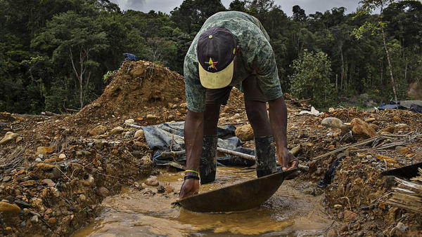 A person illegally pans for gold at a site in the Department of Choco near the city of Quibdo, Colombia, on Friday, Nov. 11, 2016. According to Santiago Angel, head of the Colombian mining association, about 85 percent of the 59 tons of gold produced last year in Colombia comes from operations without government licenses or environmental permits.