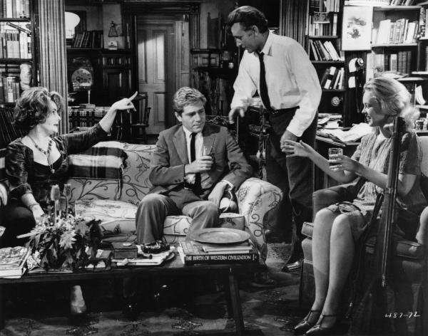 Elizabeth Taylor, (from left) George Segal, Richard Burton and Sandy Dennis starred in the 1966 film adaptation of Edward Albee's play, <em>Who's Afraid of Virginia Woolf? </em>A theater director in Portland recently cast an African-American actor as Nick (Segal's role) — and found the Albee estate withheld rights to the play.