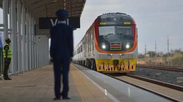 A standard gauge rail locomotive carrying Kenyan President Uhuru Kenyatta pulls into the railway station in the city of Voi on Wednesday, during an inaugural ride on the railway from Mombasa to Nairobi.