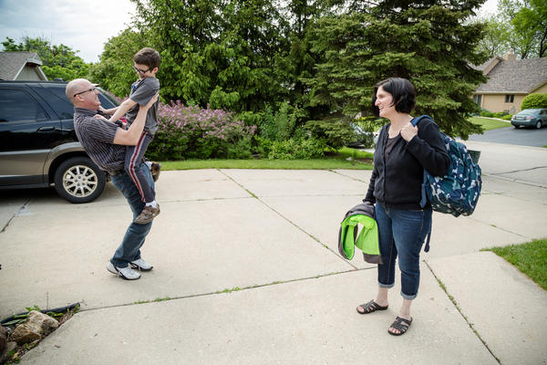 Ben Gapinski, 10, (center) is greeted by his parents Dan and Nancy Gapinski after getting off the school bus. When Ben was a toddler, he was diagnosed with an autism spectrum disorder and needed constant monitoring to stay safe.