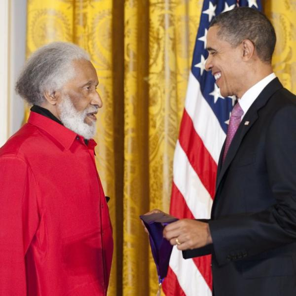 President Barack Obama presents Sonny Rollins with the 2010 National Medal of Arts.