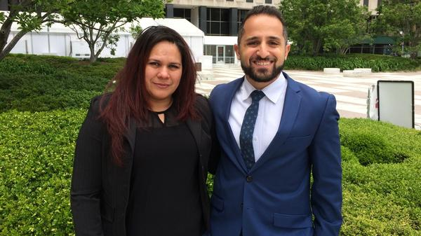 Maira, with attorney Shouan Riahi, waited more than two years to resolve her asylum case.