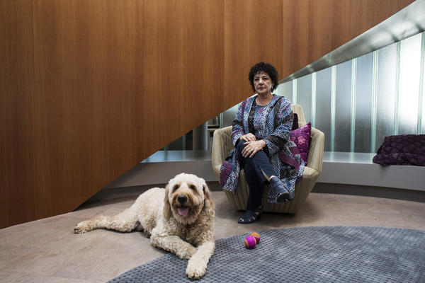 Kapor Klein sits with her rescue dog, Dudley. He acts as the office's therapy dog and follows her throughout the day.