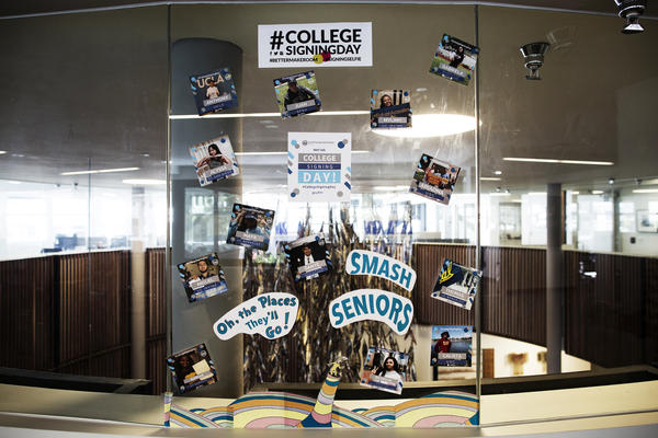 Pictures of Kapor Klein's SMASH scholars and which college they will attend are on display in the office.