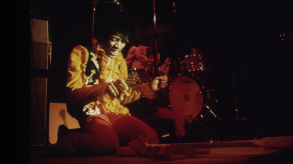 "Jimi Hendrix prepares to ""sacrifice"" his guitar at Monterey Pop in an iconic rock 'n' roll moment."
