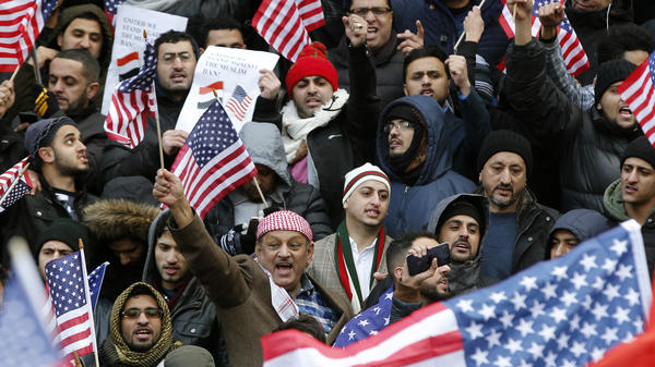 Muslims and supporters gather on the steps of Borough Hall in Brooklyn, N.Y., during a protest against President Trump's temporary travel ban in February.