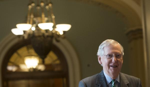 Senate Majority Leader Mitch McConnell, R-Ky., walks through the U.S. Capitol on Thursday following the release of a draft of the Senate Republicans' health care bill. An updated version was released on Monday.