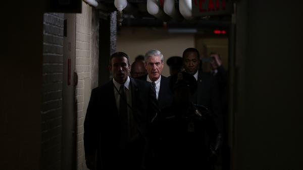 Special counsel Robert Mueller, whom the Justice Department appointed to oversee the investigation into ties between President Trump's campaign and Russia, leaves after a closed meeting with members of the Senate Judiciary Committee at the Capitol.