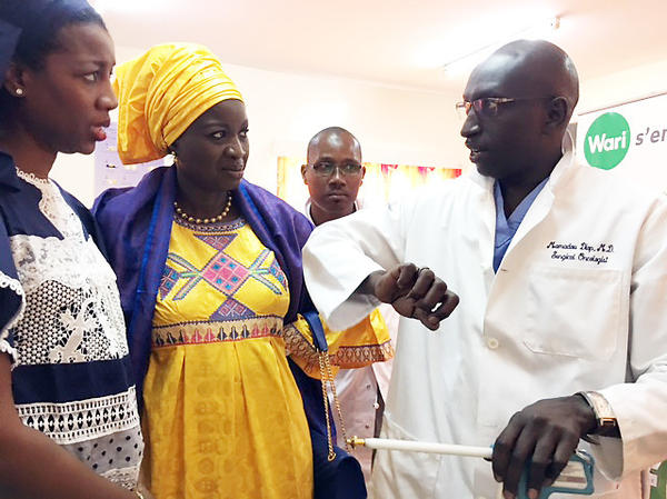 Dr. Mamadou Diop (right) is in charge of the cancer institute at Aristide Le Dantec Hospital. He's talking with members of the Senegalese Anti-Cancer League and donors.
