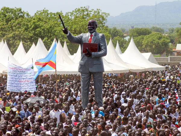 South Sundanese, watched over by a statue of rebel leader John Garang, celebrate their independence day in the capital, Juba, in 2015. This year, there will be no such celebrations.