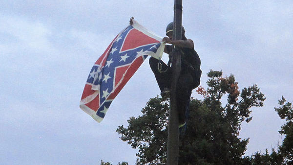 Activist Bree Newsome scaled a flagpole and removed the Confederate flag from a monument at the Statehouse in Columbia, S.C., following a deadly shooting at a historically black church in Charleston. The flag was officially removed from the grounds days later on July 10.
