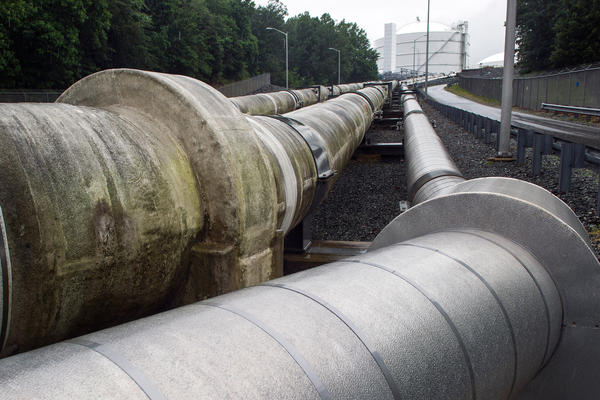 Pipelines extending from Cove Point Terminal, Dominion's nearly complete export terminal near the Chesapeake Bay in Maryland, carry liquefied natural gas to a holding tank for overseas export.