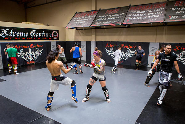 Mazany, center, spars with Puni Pagaoa during a training session. Many women in MMA regularly spar with male fighters.