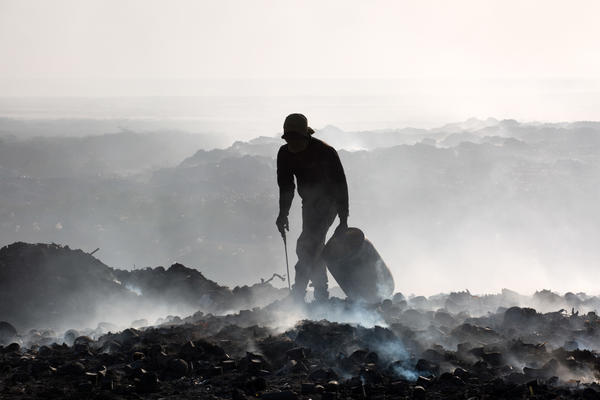 After the 2010 earthquake, NGOs dumped hundreds of thousands of gallons of raw sewage at the end of the Port-au-Prince city landfill, which borders the sea and is not lined with an impermeable material.