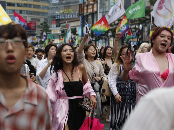 "LGBT pride celebrations took place in mid-July in Seoul. ""In comparison to other [pride celebrations] in the world, there's more protest out here,"" says actor Lee Sang-hoon (far right, in pink). ""But it makes me want to fight against them and it makes me want to win."""