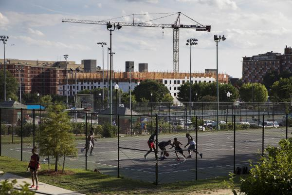 Construction of the Sherman Avenue Apartments, a Howard University co-project, rises above the courts of the Banneker Recreation Center. Though this development will include some affordable housing, it could also spur further gentrification.