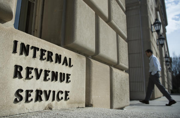 A man walks into the building of the Internal Revenue Service, which oversees the Low-Income Housing Tax Credit Program, in Washington, D.C., on March 10, 2016.